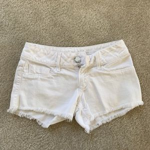 White ripped shorts size 24